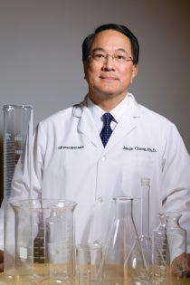 Joe Chang with beakers